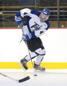 Ed Burke - The Saratogian 01/22/14 Saratoga's Jack Rittenhouse passes the puck against LaSalle during Wednesday's game in Saratoga.
