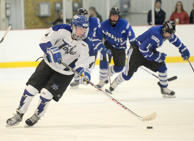 Ed Burke - The Saratogian 01/22/14 Saratoga's Jack Rittenhouse moves the puck against LaSalle during Wednesday's game in Saratoga.