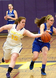 Ed Burke - The Saratogian 01/30/14 Saratoga Central Catholic's Melody Ashline strips the ball from Mayfield's Kylie Manoogian during Thursday's game in Saratoga.