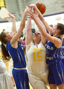 Ed Burke - The Saratogian 01/30/14 Saratoga Central Catholic's Melody Ashline is pressured by Mayfield's Lyndsey Barber, left, and Alex Sheldon during Thursday's game in Saratoga.