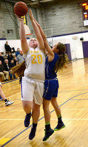 Ed Burke - The Saratogian 01/30/14 Saratoga Central Catholic's Anlyn Billington shoots under pressure from Mayfield defender Caily Meca during Thursday's game in Saratoga.