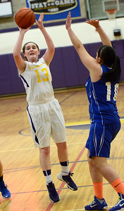 Ed Burke - The Saratogian 01/30/14 Saratoga Central Catholic's Emma VanDeCar takes a shot during Thursday's game against Mayfield in Saratoga.