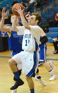 Ed Burke - The Saratogian 01/31/14 Saratoga's Chris Byno takes a shot as Shaker's Andrew Holmes closes in during Friday's varsity basketball matchup at Saratoga.