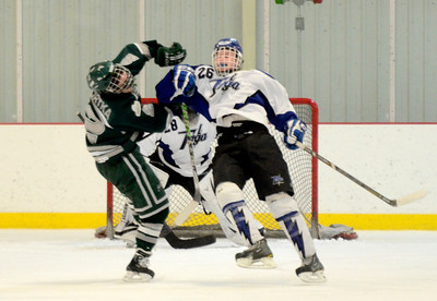 Ed Burke - The Saratogian 02/06/14; Saratoga's Elliott Hungerford and Shen's Ryan Mortka collide during Thursday's varsity hockey matchup at Saratoga Springs Ice Rink.