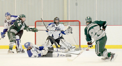 Ed Burke - The Saratogian 02/06/14; Saratoga goalie Danny Hobbs keeps his eye on the puck as he stops a shot by Shen's Cameron Kuhl during Thursday's varsity hockey matchup at Saratoga Springs Ice Rink.