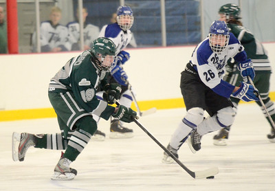 Ed Burke - The Saratogian 02/06/14; Shen's Peter Russo moves the puck as Saratoga's Elliott Hungerford closes in during Thursday's varsity hockey matchup at Saratoga Springs Ice Rink.