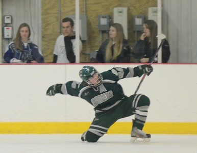 Ed Burke - The Saratogian 02/06/14; Shen's Kyle Marr pumps his fist after his first period goal during Thursday's varsity hockey matchup at Saratoga Springs Ice Rink.