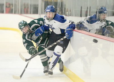 Ed Burke - The Saratogian 02/06/14; The puck sails into the corner as Shen's Nick Quigley and Saratoga's Kevin Knox battle along the boards during Thursday's varsity hockey matchup at Saratoga Springs Ice Rink.