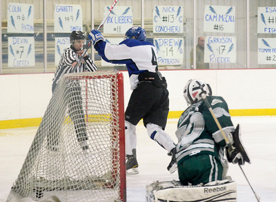 Ed Burke - The Saratogian 02/06/14; Saratoga's Jack Rittenhouse celebrates after scoring a first period goal past Shenendehowa goalie Jordan Moffre during Thursday's varsity hockey matchup at Saratoga Springs Ice Rink.