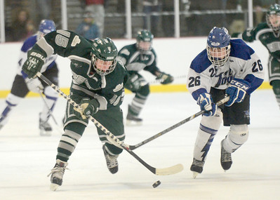 Ed Burke - The Saratogian 02/06/14; Saratoga's Elliott Hungerford and Shen's Tucker Marvin battle for the puck during Thursday's varsity hockey matchup at Saratoga Springs Ice Rink.
