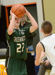 Ed Burke - The Saratogian 02/07/14; Greenwich's John Stewart takes aim during Friday's matchup in Schuylerville.