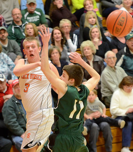 Ed Burke - The Saratogian 02/07/14; Schuylerville's Nick Richard fires a pass over Greenwich defender Sean Estramonte during Friday's matchup in Schuylerville.