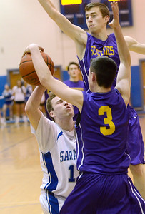Ed Burke - The Saratogian 02/11/14 Saratoga's Chris Byno is stuffed by Ballston's Andrew Gentile, backed up by  Sean Walsh during Tuesday's game at Saratoga.