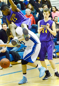Ed Burke - The Saratogian 02/11/14 Ballston Spa's Andre Edgerton heads for a hard landing after Saratoga's Noah Arciero faked a shot during Tuesday's game at Saratoga.