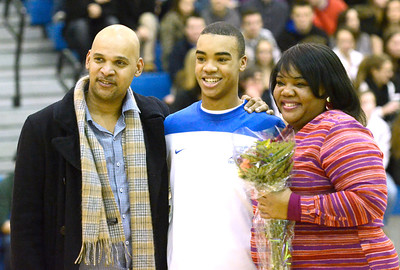 Ed Burke - The Saratogian 02/11/14 Saratoga's Cam Ellis stands with his mother Valerie and uncle Ron during Senior Night at Tuesday's game versus Ballston Spa at Saratoga.