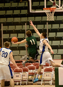Ed Burke - The Saratogian 02/26/14 Greenwich's Sean Estramonte is pressured by Hoosic Valley's Mike Pierre during Wednesday's Class C semi-final in Glens Falls.