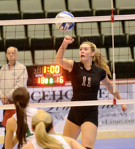 Ed Burke - The Saratogian Burnt Hills-Ballston Lake volleyball player Jessica Dillon punches the ball toward the net during Saturday's state volleyball championships at the Glens Falls Civic Center.