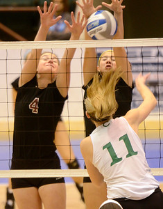 Ed Burke - The Saratogian Burnt Hills-Ballston Lake volleyball players Natalie Albright (4) and Natalie Shurman team up to block a shot by Cornwall's Alex Jurgens during Saturday's state volleyball championships at the Glens Falls Civic Center.