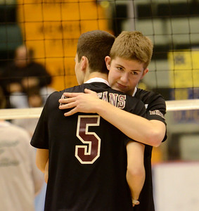 Ed Burke - The Saratogian Burnt Hills-Ballston Lake volleyball players Cody Pearce, facing, and Sam Peltom embrace after losing to Kennedy High School during Friday's state volleyball championships at the Glens Falls Civic Center.