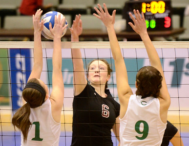Ed Burke - The Saratogian Burnt Hills-Ballston Lake volleyball player Emma Sprotbery hits into defense by Cornwall's Pat Harnett (1) and Eva Lynch during Saturday's state volleyball championships at the Glens Falls Civic Center.