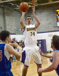 Ed Burke - The Saratogian 11/29/13 Saratoga Central Catholic's Evan Pescetti takes a shot over South High during the Mike Beson Memorial Basketball Tournament Friday at Saratoga Central Catholic.
