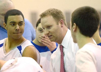 Ed Burke - The Saratogian 12/03/13 Blue Streal coach Matt Usher talks with his team before Tuesday's contest against Queensbury.