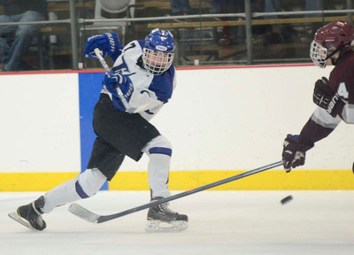 Ed Burke - The Saratogian 12/07/13 Saratoga's Devin Coffey shoots as St. Joseph's Brad Kaminski tries to block during Saturday's action in the Don Kauth Memorial Tournament at Saratoga Springs Ice Rink.