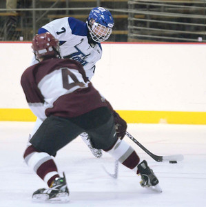 Ed Burke - The Saratogian 12/07/13 Saratoga's Devin Coffey scores on this shot as St. Joseph's Brad Kaminski tries to block during Saturday's action in the Don Kauth Memorial Tournament at Saratoga Springs Ice Rink.