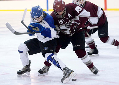 Ed Burke - The Saratogian 12/07/13 Saratoga's Josh Dagle tries to get his skate on the puck while battling St. Joseph's Nick Zenger during Saturday's action in the Don Kauth Memorial Tournament at Saratoga Springs Ice Rink.