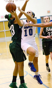 Ed Burke - The Saratogian 12/13/13 Saratoga's Ann Mahoney drives to the basket past Shen's Sydney Brown during Friday's game at Saratoga.