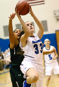 Ed Burke - The Saratogian 12/13/13 Saratoga's Maddie Klotz goes up as Shen's Samira Sangare tries to block during Friday's game at Saratoga.