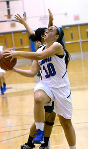 Ed Burke - The Saratogian 12/13/13 Saratoga's Ann Mahoney drives to the basket past Shen's Sydney Quinn during Friday's game at Saratoga.