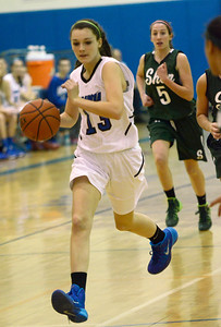 Ed Burke - The Saratogian 12/13/13 Saratoga's Maddie Chudy moves the ball against Shen during Friday's game at Saratoga.