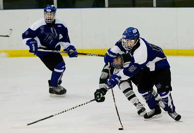 Erica Miller - The Saratogian @togianphotog      12/18/13. Saratoga's Cam McCall with the puck against Shenendehowa's Marvin Tucker during their hockey game in Clifton Park.SAR-l-TogaHockey1
