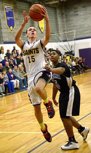 Ed Burke - The Saratogian 12/27/13 Saratoga Central Catholic's Brian Hall tries for two over Bishop Maginn's Marcus Friend during Friday's action in Saratoga Central Catholic's Christmas basketball tournament.