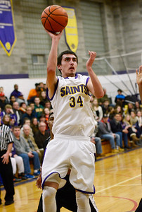 Ed Burke - The Saratogian 12/27/13 Saratoga Central Catholic's Evan Pescetti tries for two versus Bishop Maginn during Friday's action in Saratoga Central Catholic's Christmas basketball tournament.