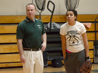 Ed Burke - The Saratogian 04/02/14 Greenwich softball coach Greg McGuirk stands with player Jessica James during Wednesday's indoor practice in the school's gym.