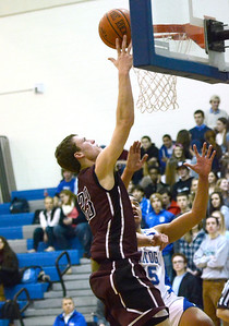 Ed Burke - The Saratogian 01/10/14 Burnt Hills-Ballston Lake's Austin Nydegger tries for two during Friday's game at Saratoga.