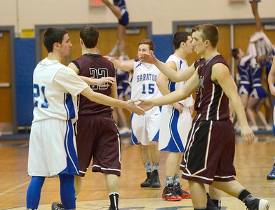 Ed Burke - The Saratogian 01/10/14 The Saratoga Springs Blue Streaks and Burnt Hills- Ballston Lake Spartans greet each before Friday's varsity basketball matchup at Saratoga.
