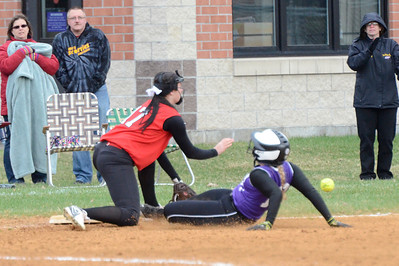 Ed Burke - The Saratogian 04/23/14 Ballston's Payton Witalec triples in the 5th beating the throw to Guilderland's Maddie Harrington during Wednesday's game at Ballston Spa.