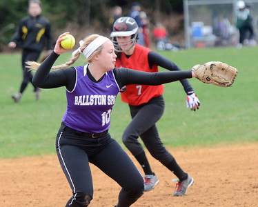 Ed Burke - The Saratogian 04/23/14 Guilderland's Doris Kane heads to third base as Ballston's Payton Witalec throws Mack Lozano out at first during Wednesday's game at Ballston Spa.