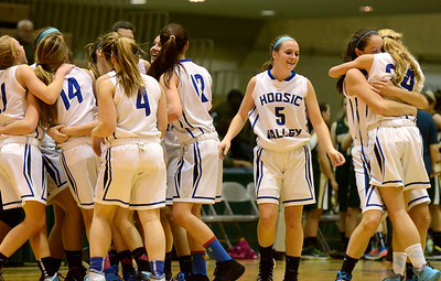 Ed Burke - The Saratogian 03/08/14 Hoosic Valley celebrates their Class C regional win over Northern Adirondack Saturday in Troy.