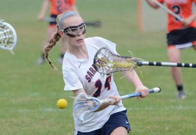 Ed Burke - The Saratogian 04/22/14 Saratoga's Cassidy Henderson takes a shot during Tuesday's varsity lacrosse game against Bethlehem at Saratoga.