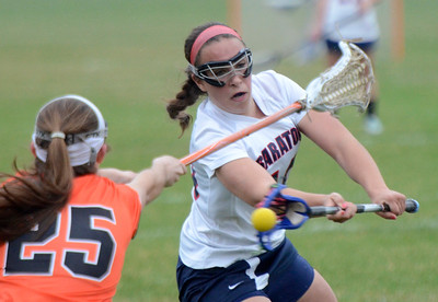 Ed Burke - The Saratogian 04/22/14 Saratoga's Ann Mahoney takes a shot on goal as Bethlehem's Abigail McDonald reaches to block during Tuesday's varsity lacrosse game at Saratoga.