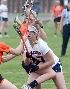 Ed Burke - The Saratogian 04/22/14 Saratoga's Cameron Parry runs into rough defense with Behlehem's Elena Kreienberg during Tuesday's varsity lacrosse game at Saratoga.
