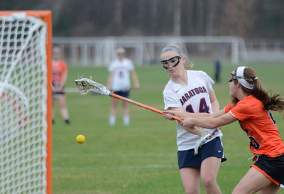 Ed Burke - The Saratogian 04/22/14 Saratoga's Cassidy Henderson scores as Bethlehem's Abigail McDonald reaches to block during Tuesday's varsity lacrosse game at Saratoga.