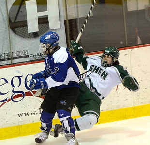 Ed Burke - The Saratogian 02/25/14 Shen's Peter Sacks hits the ice after colliding with Saratoga's Grayson Rieder during Tuesday's matchup at Union College.