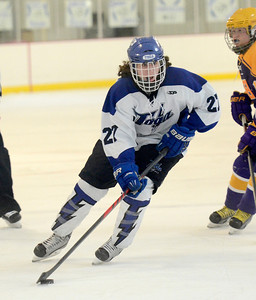 Ed Burke - The Saratogian 02/19/14 Saratoga's JT Rafferty moves the puck during sectional action against CBA Wednesday in Saratoga.