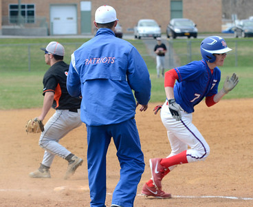 Ed Burke - The Saratogian 04/19/14  Broadalbin-Peth's Zach Morreale heads home to score for the Patriots during Saturday's game at Schuylerville.