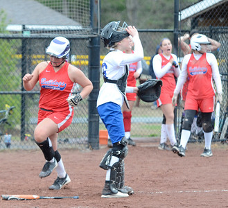 Ed Burke - The Saratogian 04/29/13 South High's Emily Sharpe scores on a hit by Elyse Green during Tuesday's game at Moreau Rec Park. Celyna Shaw works the plate for Queensbury.